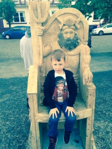 Little boy on story telling chair
