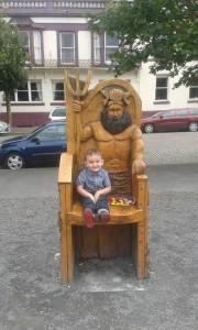 Little boy on story tellingchair