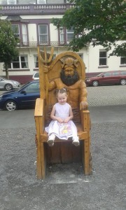 Little girls on story telling chair