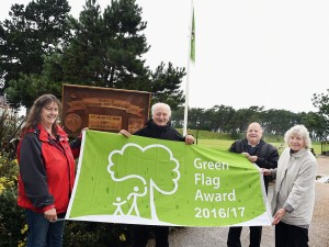 Green Flag Award for Silloth.  pic MIKE McKENZIE 28th July 2016 Three of the members of the Silloth ibn Bloom Committee with the Green Flag Award Silloth has gained ahead of the Britain in Bloom judges arriving.  from the left, Wendy Jameson; Bill Jefferson; former mayor Graham Wilkinson and Anne Winter.  pic Mike McKenzie